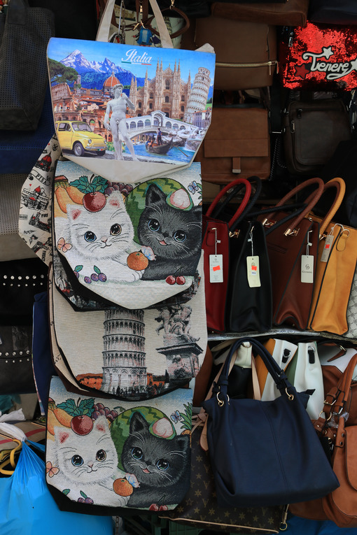 Souvenir bags of the leaning tower of Pisa. Market stalls in the - MyVideoimage.com