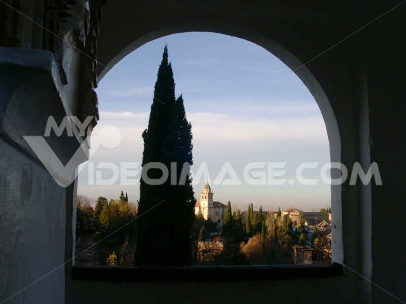 Spain. View of the Alhambra in Granada framed by an arch. Granada foto. Granada photo