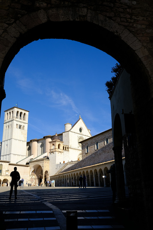 Square with the Basilica of San Francesco and the silhouette of a military security officer against terrorism. - MyVideoimage.com