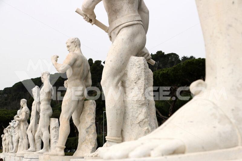 Stadio dei marmi, Rome. Sculptures. Sculptures in white Carrara marble at the Stadio dei Marmi in Rome at the Foro Italico. - MyVideoimage.com