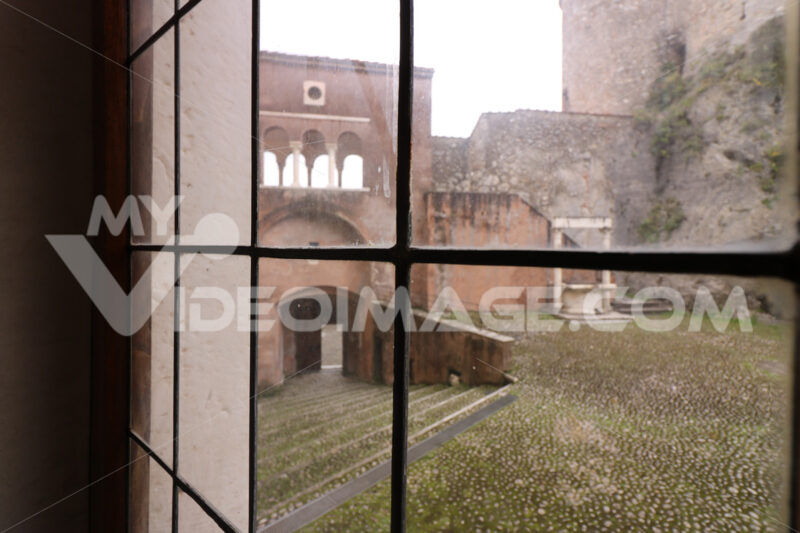 Stained glass window with a view of the courtyard of the Malaspina di Massa castle. - MyVideoimage.com