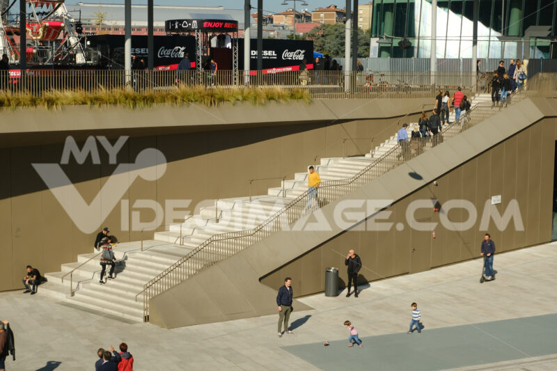 Staircase of the Citylife shopping center in Milan. Square with connecting stairs crossed by many people. - MyVideoimage.com