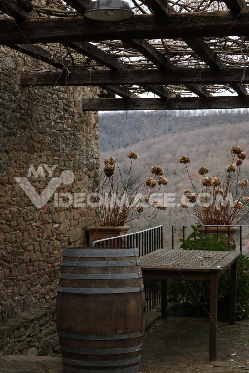 Still life with dried flowers, table and wooden barrel in the Tu - MyVideoimage.com