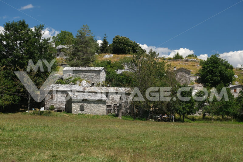 Stone chalet  in Campocatino, in the green valley of the Apuan Alps mountains. Alpine landscape with a small village. - MyVideoimage.com | Foto stock & Video footage