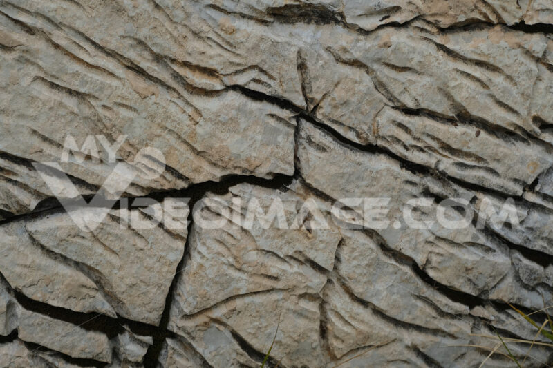 Stone eroded by water. Stone carved by water erosion on the mountain surface. Stock photos. - MyVideoimage.com | Foto stock & Video footage