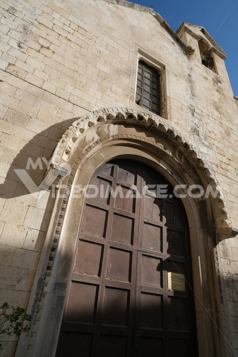 Stone portal of the small medieval church of Giovanni Crisostomo, or Giovanni d'Antiochia in Bari. Foto Bari photo.