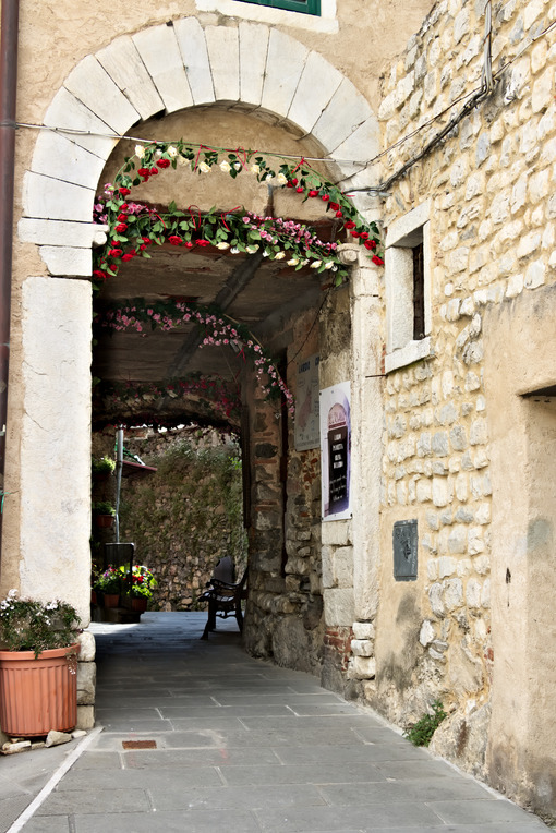Street of the ancient village of Colonnata, famous for the production of lard. The ancient village of white marble quarrymen is located above Carrara, in northern Tuscany. - MyVideoimage.com