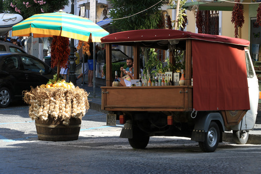 Street vendor selling typical products with Ape Car. Liqueurs, w - MyVideoimage.com