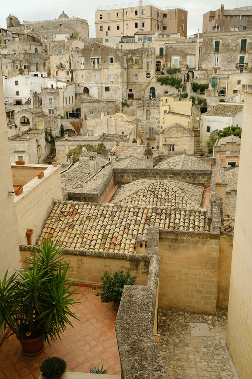 Streets, alleys and courtyards of the city of Matera. Typical houses built with blocks of tufa stone of beige color. - MyVideoimage.com