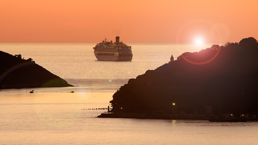Sunset cruise. Cruise ship anchored near Portovenere and Palmaria island. Stock photos. - MyVideoimage.com | Foto stock & Video footage