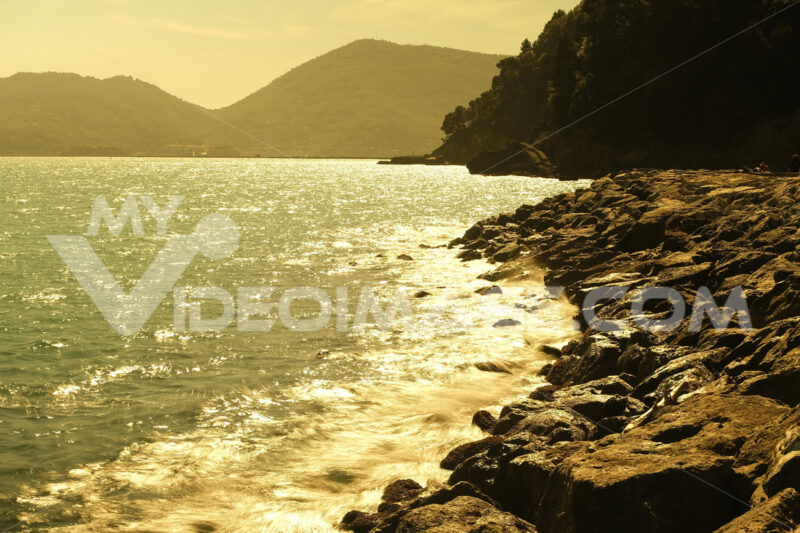 Sunset in the gulf. Sunset over the sea in the Gulf of La Spezia, near Cinque Terre. Stock photos. - MyVideoimage.com | Foto stock & Video footage
