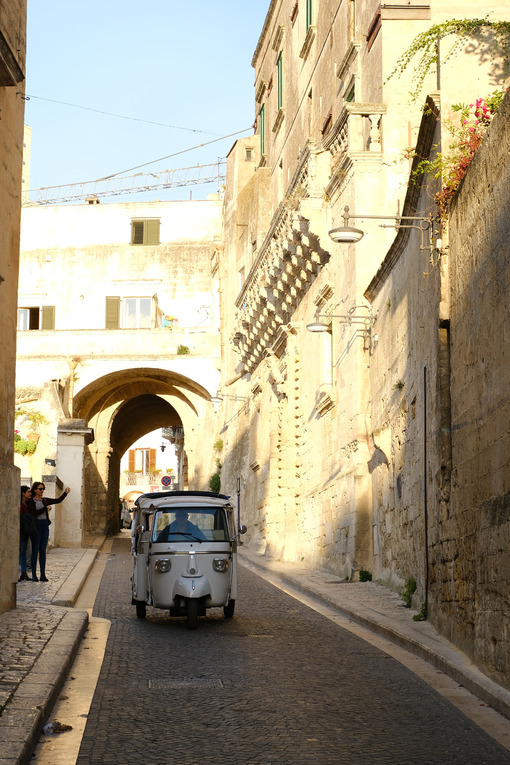 Taxi Ape Calessino Piaggio in a street of the city of Matera. Motorcycle turned into an auto-taxi suitable for the streets of the Italian town. - MyVideoimage.com