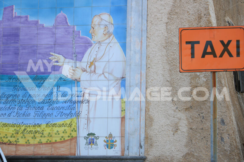 Taxi parking sign and mural on ceramic with the image of Pope Sa - MyVideoimage.com