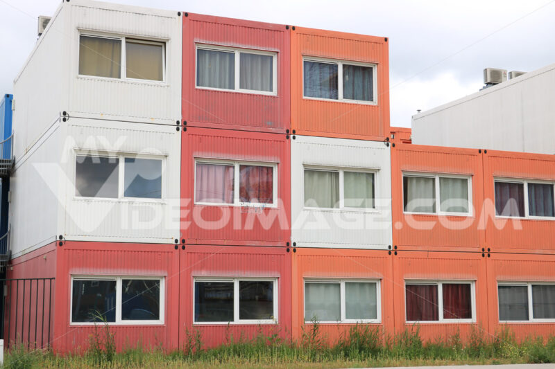 Temporary housing in steel containers. Overlapping containers wi - MyVideoimage.com