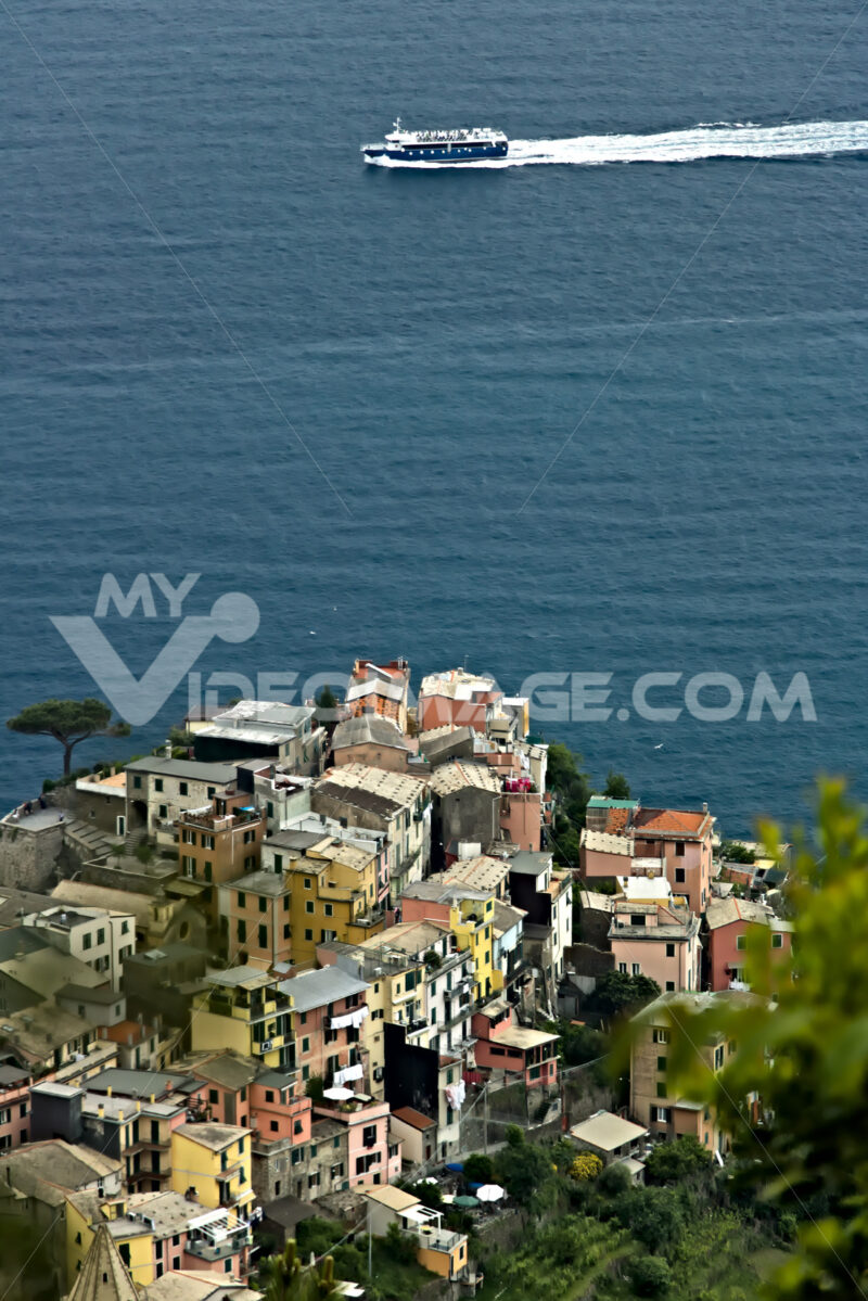 The village of Corniglia, Cinque Terre seen from a path on the hill overlooking the sea. - MyVideoimage.com