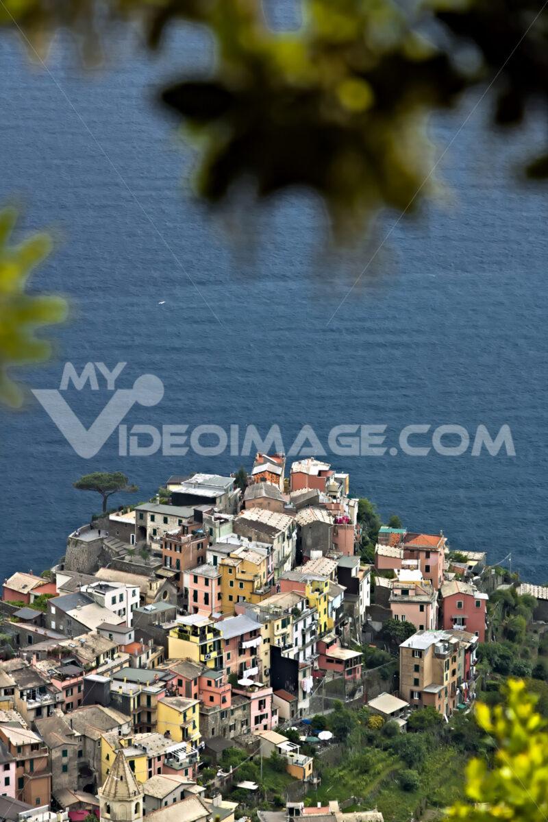 The village of Corniglia, Cinque Terre seen from a path on the hill overlooking the sea. Foto mare. - LEphotoart.com