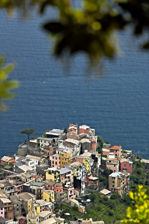 The village of Corniglia, Cinque Terre seen from a path on the hill overlooking the sea. Foto mare. - LEphotoart.com
