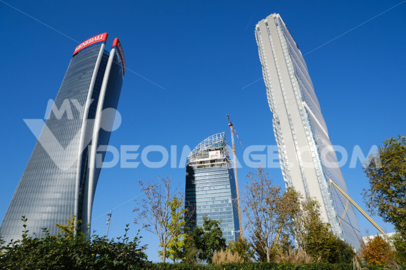 Three Citylife towers designed by Isozaki, Hadid and Libeskind. Milan. CityLife includes three skyscrapers and areas with tree and green gardens. Città italiane. Italian cities.