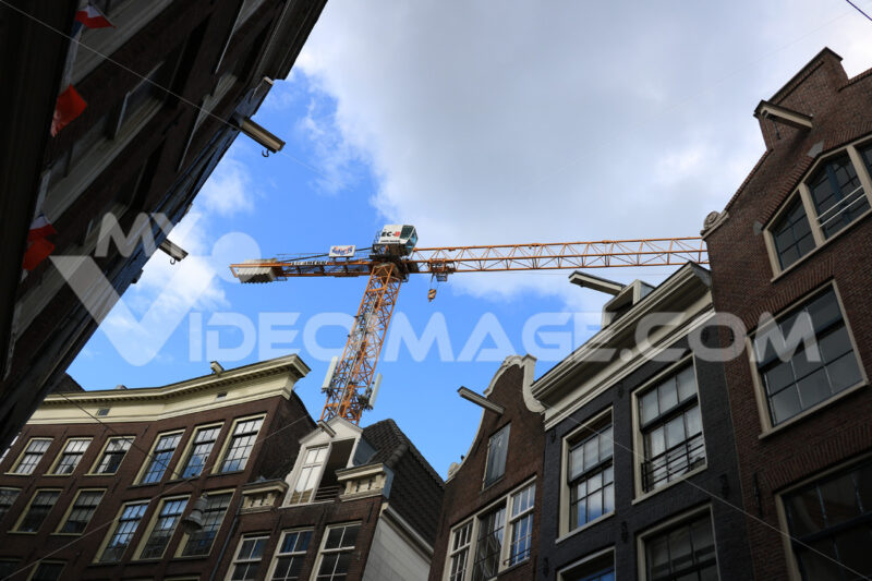 Tower crane at a construction site in the historic city center. - MyVideoimage.com