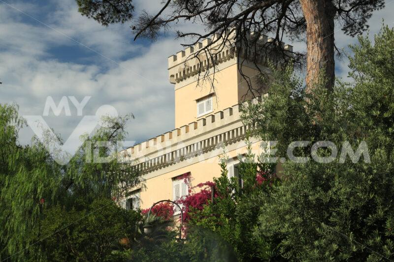 Tower of a Mediterranean villa with green park. Rich vegetation - MyVideoimage.com