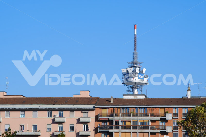 Tower with antennas and TV radio repeaters of the RAI of Milan. In the foreground buildings with residential houses. - MyVideoimage.com