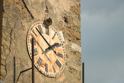 Tower with clock and bell tower in Castiglione della Pescaia. An ancient village in the Tuscan Maremma built on a hill facing the sea. - MyVideoimage.com