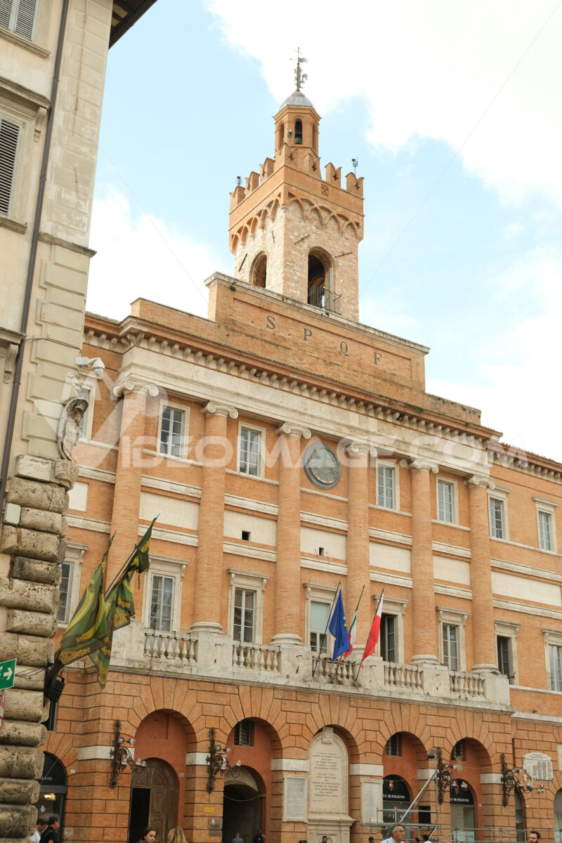 Town Hall of Foligno with flags on the facade that move with the wind. - LEphotoart.com