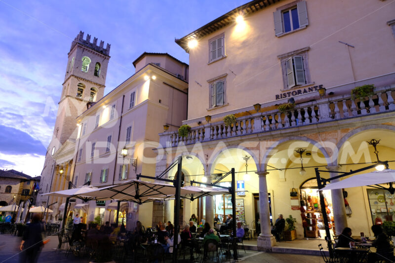 Town square of Assisi with the Torre del Popolo and fountain at night. The city of San Francesco with the lights of the night. - LEphotoart.com
