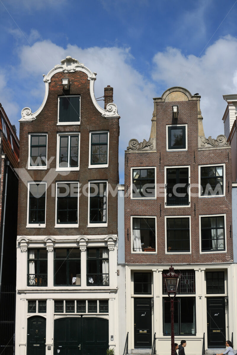 Typical Dutch houses seen from the canals of Amsterdam. Amsterdam foto. Amsterdam photo
