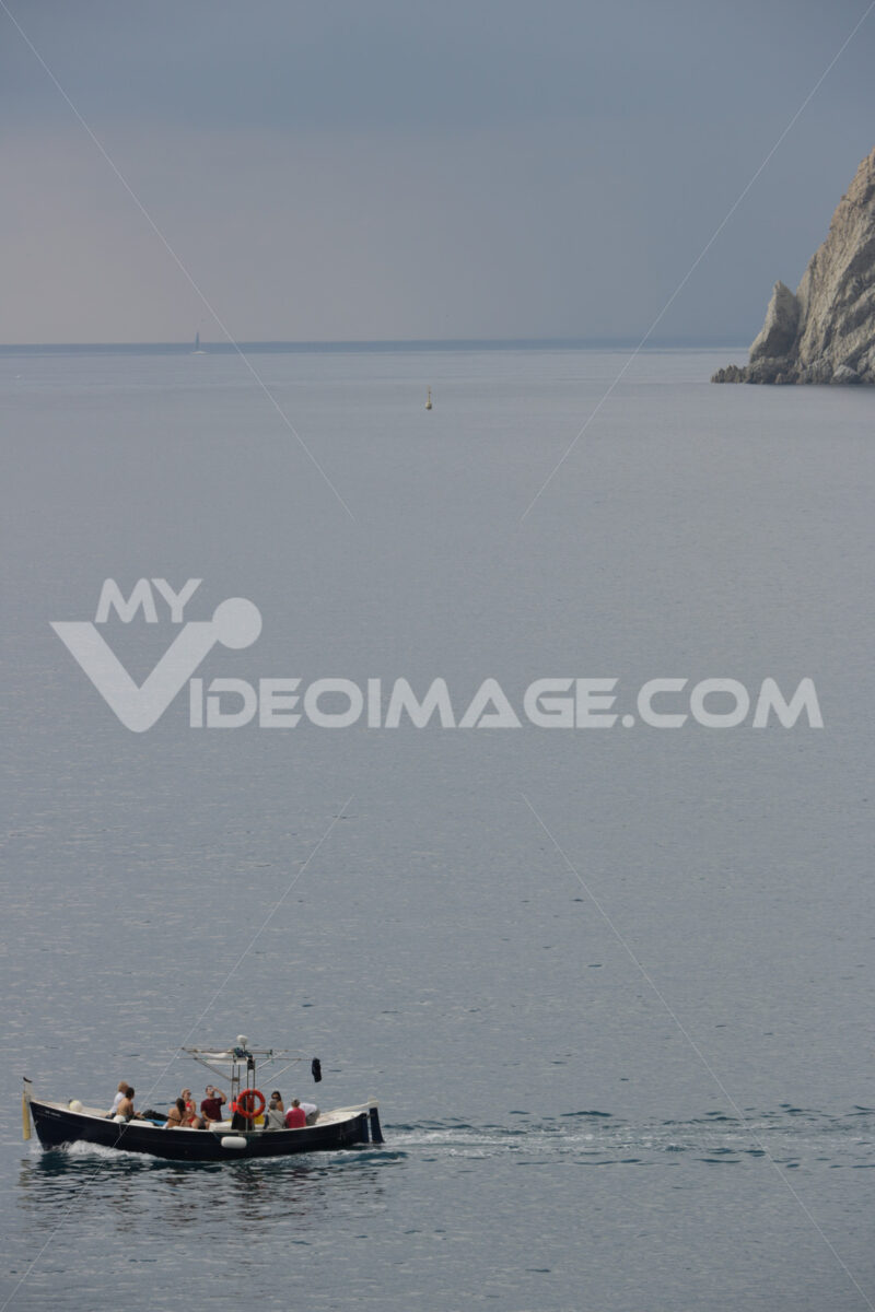 Typical Ligurian boat with tourists in the Cinque Terre sea. - MyVideoimage.com