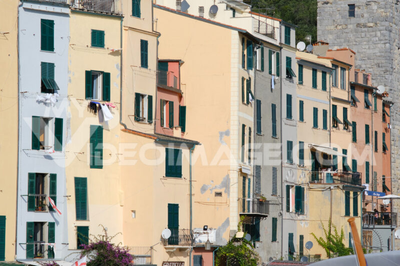 Typical Ligurian houses in the village of Portovenere. In the background a tower belonging to the walls of the fort. - MyVideoimage.com
