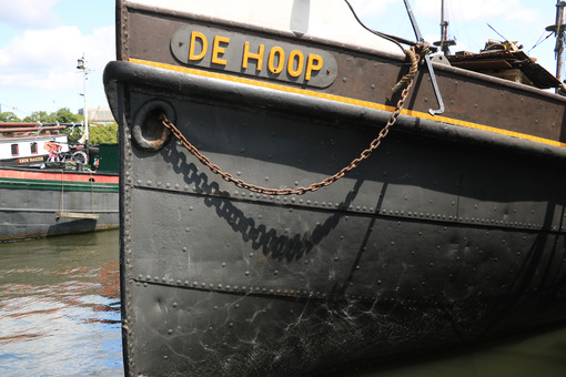 Typical transport boat anchored in the Amsterdam canals. Amsterdam foto. Amsterdam photo