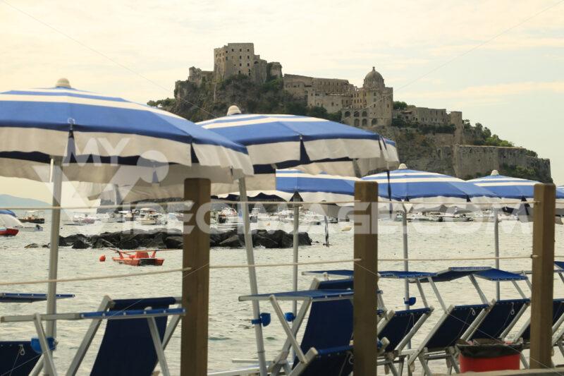 Umbrellas and deckchairs on the beach of Ischia Porto. Foto Ischia photos.