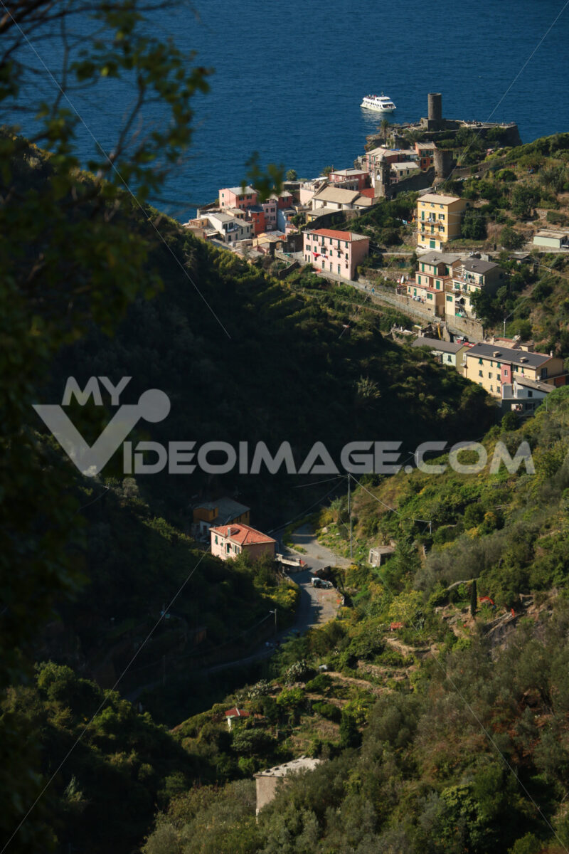 Vernazza village seen from the path that goes up the hill to the Cinque Terre. Castle with the cylindrical tower. - MyVideoimage.com