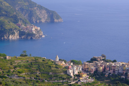 View from above of the village of Corniglia in the Cinque Terre. Perched on the mountain overlooking the sea, it is a UNESCO heritage site. - MyVideimage.com