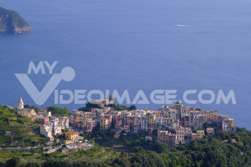 View from above of the village of Corniglia in the Cinque Terre. Perched on the mountain overlooking the sea, it is a UNESCO heritage site. - MyVideoimage.com