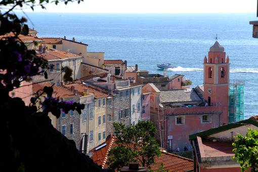 Village of Tellaro di Lerici near the Cinque Terre. Top view with the church bell tower, the houses and the sea. - MyVideoimage.com