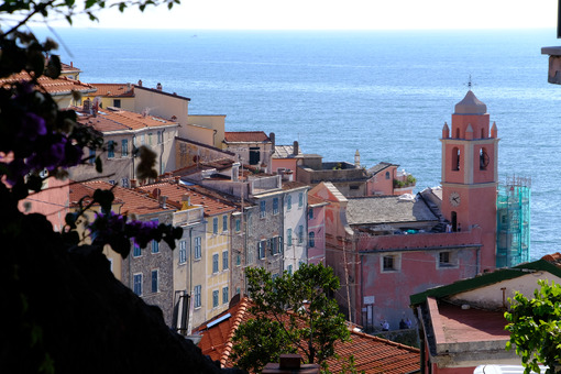 Village of Tellaro di Lerici near the Cinque Terre. Top view with the church bell tower, the houses and the sea. - LEphotoart.com