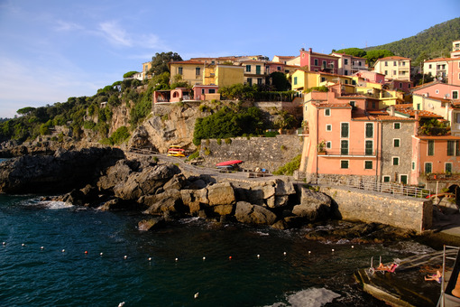 Village of Tellaro di Lerici near the Cinque Terre. View of the village illuminated by the light of the sunset. Houses. - MyVideoimage.com