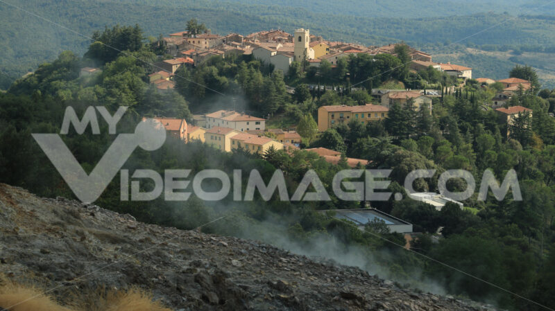 Volcanic fumaroles in the geothermal field in the town of Monterotondo M. Geothermal energy in Tuscany on the metalliferous hills near Larderello. - MyVideoimage.com