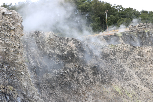 Volcanic fumaroles in the geothermal field. Jets of steam come out of the earth. Monterotondo, Larderello, Tuscany, Italy. - MyVideoimage.com