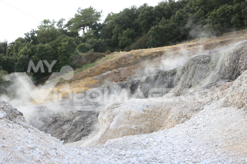 Volcanic fumaroles in the geothermal field. Jets of steam come out of the earth. Monterotondo, Larderello, Tuscany, Italy. - LEphotoart.com