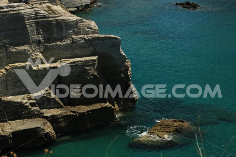 Volcanic rocks and rocks in the Mediterranean sea of Ischia. Foto Ischia photos.