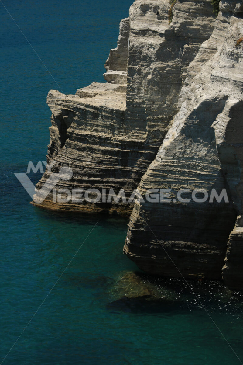 Volcanic rocks and rocks in the Mediterranean sea of Ischia. Clo - MyVideoimage.com