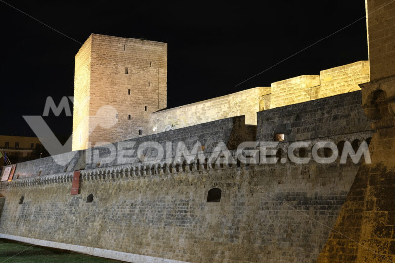 Walls of the Norman Swabian castle of Bari. Filming with night lighting of the fort built by Frederick II. Foto Bari photo.