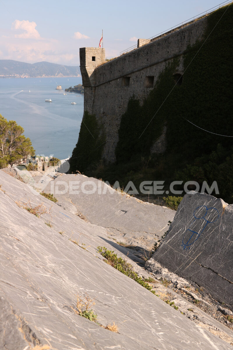 Walls of the castle of Portovenere with turret and the background of the sea. - MyVideoimage.com