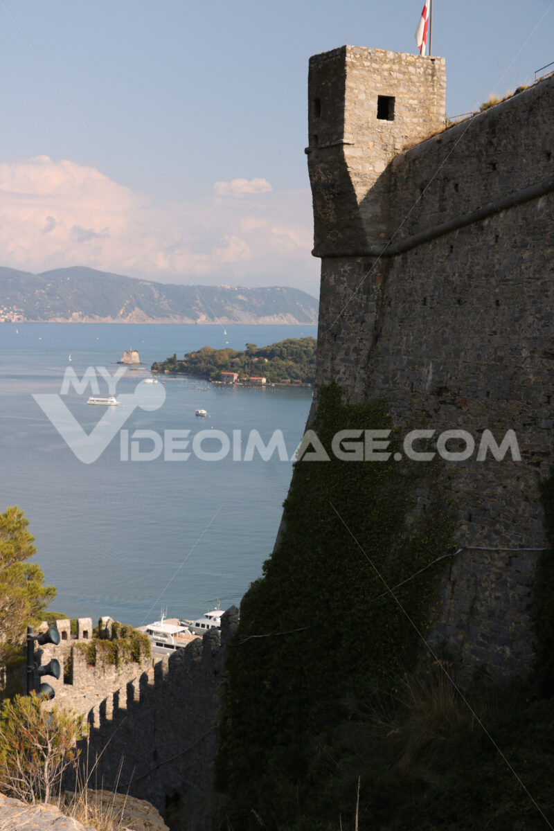 Walls of the castle of Portovenere with turret and the background of the sea. Sea pictures - LEphotoart.com
