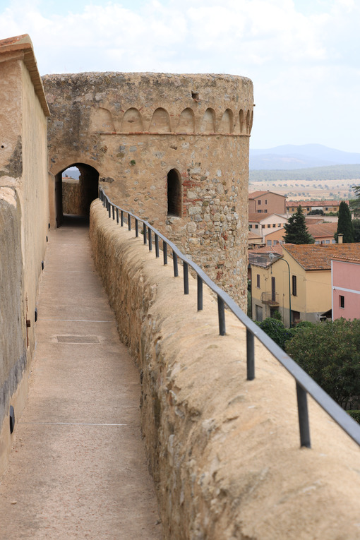 Walls of the town of Magliano in Tuscany. Maremma. 	Path on the castle walls. Landscape with countryside of the hills. - MyVideoimage.com