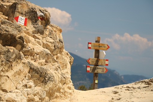 Warning signs on the paths of the Cinque Terre, Wooden arrows on a pole made by CAI, the Italian Alpine Club. - MyVideimage.com