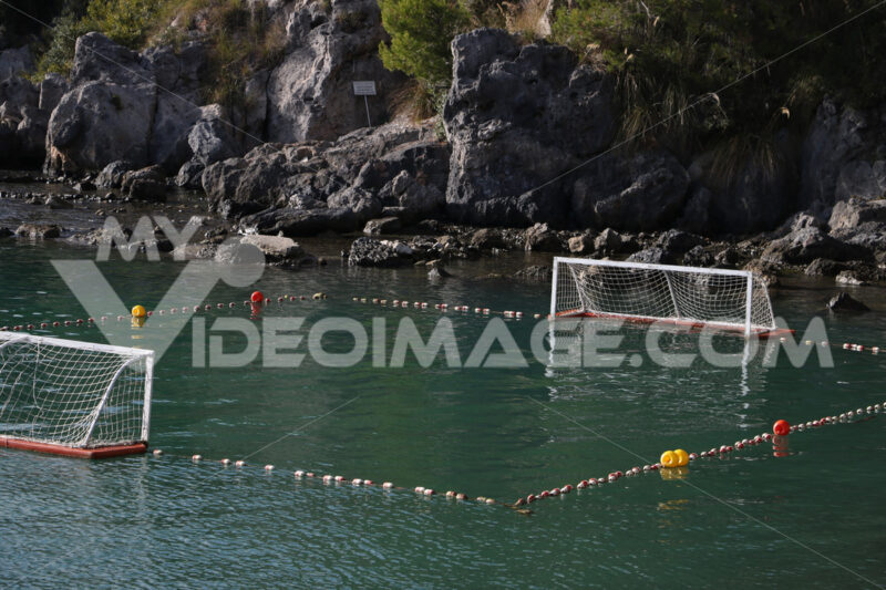 Water polo field with doors and floats in the green sea. - MyVideoimage.com